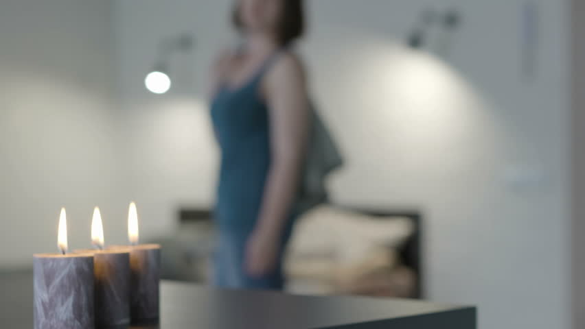 Girl standing in the room with candles | Shutterstock HD Video #31419532