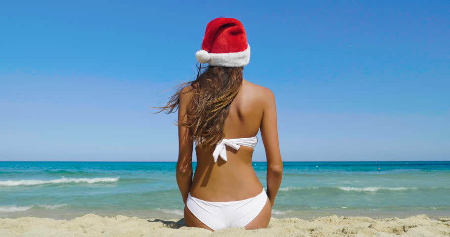 Are women in white bikini on her back All