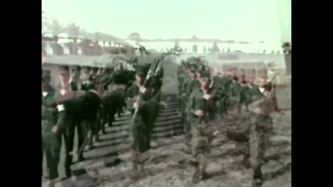 CIRCA 1973 - Recruits march, run, compete in a tug of war, climb a rope and disassemble rifles at Marine Corps Recruit Depot San Diego, California.