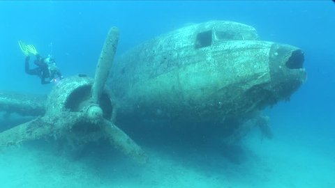 scuba diver girl underwater air plane wreck aircraft