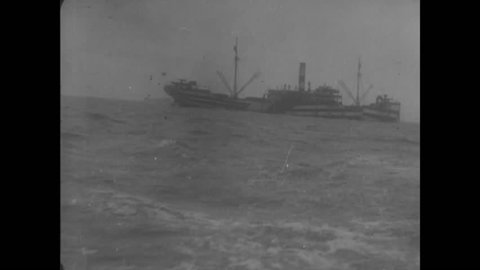 CIRCA 1918 - Various watercraft, including a sailing vessel and a warship, are shown at sea and cargo is unloaded from ships at a port in France.