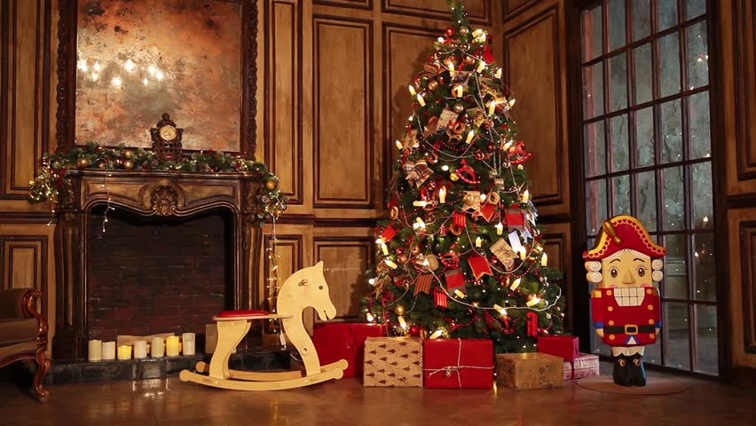 Classic New Year Tree illuminated. Christmas decoration in grunge room interior with fireplace, horse rocking kids chair | Shutterstock HD Video #31455862