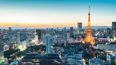 Timelapse view of Tokyo city at twilight with Tokyo Tower and Mt Fuji on the background