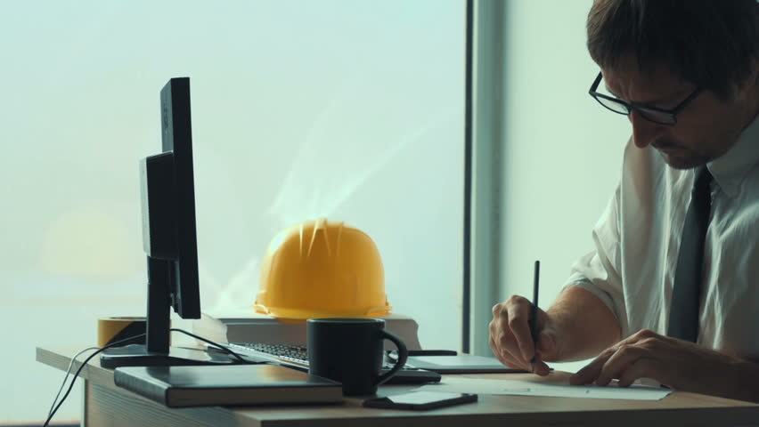 Construction engineer using pencil to sketch project on paper in architecture studio office | Shutterstock HD Video #31513870