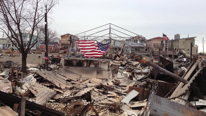 BREEZY POINT, QUEENS, NY-December 2, 2012: Video clip of wreckage and debris from homes destroyed by devastating fire during Hurricane Sandy.  American flag is draped in background of fallen homes.