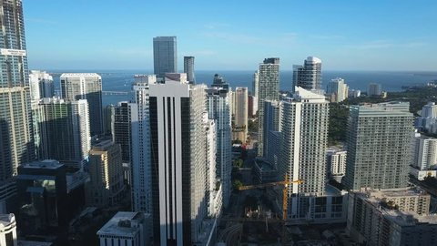 4K Aerial shot through buildings in Miami Downtown