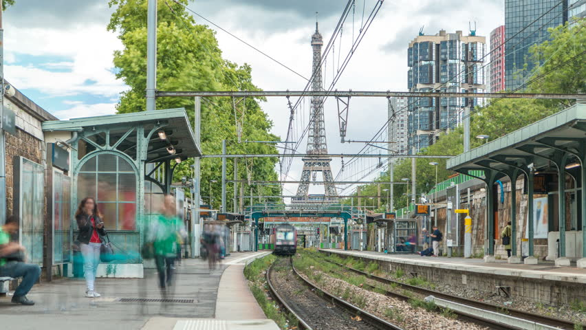 Javel train station with Eiffel tower on background timelapse. It is a French railway station on the Invalides line of Paris, in the Javel district. Cloudy sky at summer day. Paris, France | Shutterstock HD Video #31567612