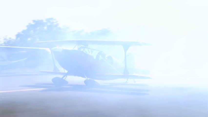 Biplane Spinning with Smoke