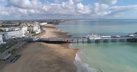 Aerial approaching the seafront and the Victorian pier in Eastbourne, Southern England