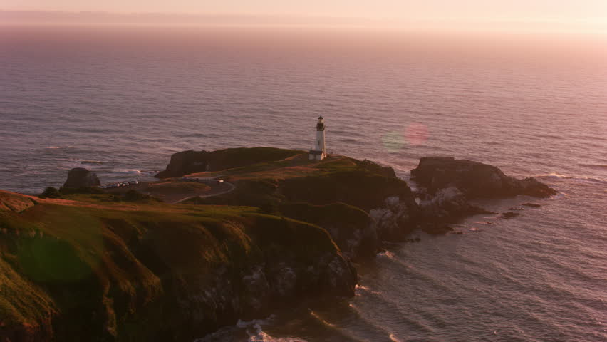 Newport, Oregon circa-2017, Aerial shot of Yaquina Head Lighthouse at sunset. Shot with Cineflex and RED Epic-W Helium.