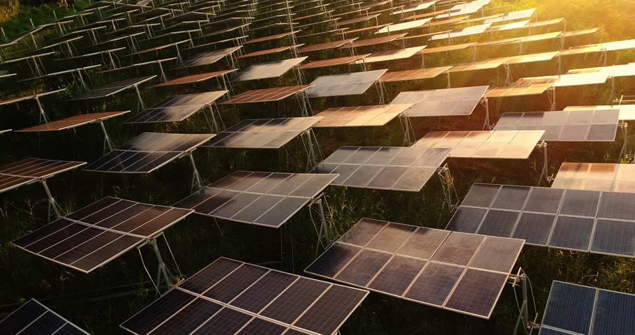 4K Aerial view of Solar Panels Farm (solar cell) with sunlight.Drone flight fly over solar panels field renewable green alternative energy concept in Thailand. | Shutterstock HD Video #31651372