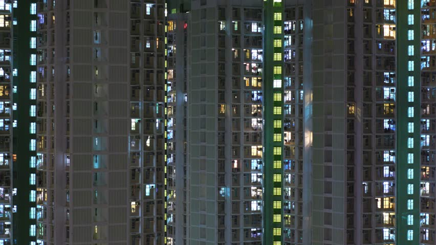 Time lapse of building facade in Hong Kong at night  #31654792