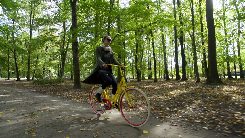 Beautiful girl riding bicycle in park  | Shutterstock HD Video #31660402