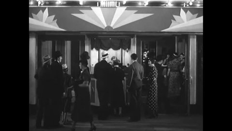 CIRCA 1940 - Moviegoers attend the premiere of a film at the Pantages Theater in Hollywood, California and a scientific motion picture camera is shown.E
