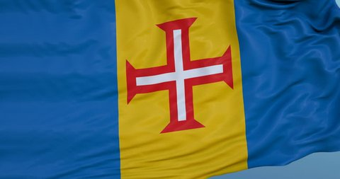 Seamlessly Looping flag for Madeira Islands, blowing beautifully in the wind. Slo-Motion. Available in 4K.