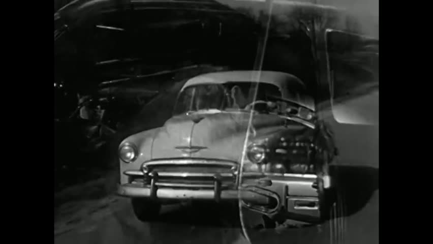CIRCA 1950s - A family drives a Chevrolet car with a windshield that affords a panoramic view and structural stel girders are shown, in 1950.