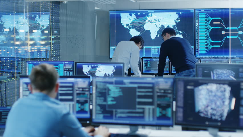 In the System Control Room Project Manage and IT Engineer Have Discussion, they're surrounded by Multiple Monitors with Graphics. Big Monitor Shows Interactive Logistics Map. | Shutterstock HD Video #31689652