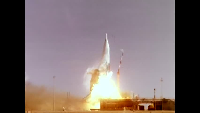 CIRCA 1960s - An Atlas ICBM Missile lifts off from a National Defense Area, in the desert, in 1961. | Shutterstock HD Video #31697392