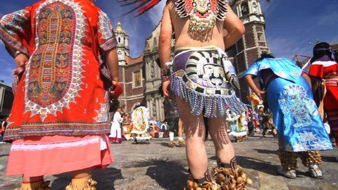 MEXICO CITY, MEXICO - DECEMBER 12, 2012: Aztec dance performers in traditional costume perform in the Plaza Mariana of the Basilica of the Virgin of Guadalupe in Mexico city on December 12, 2012.