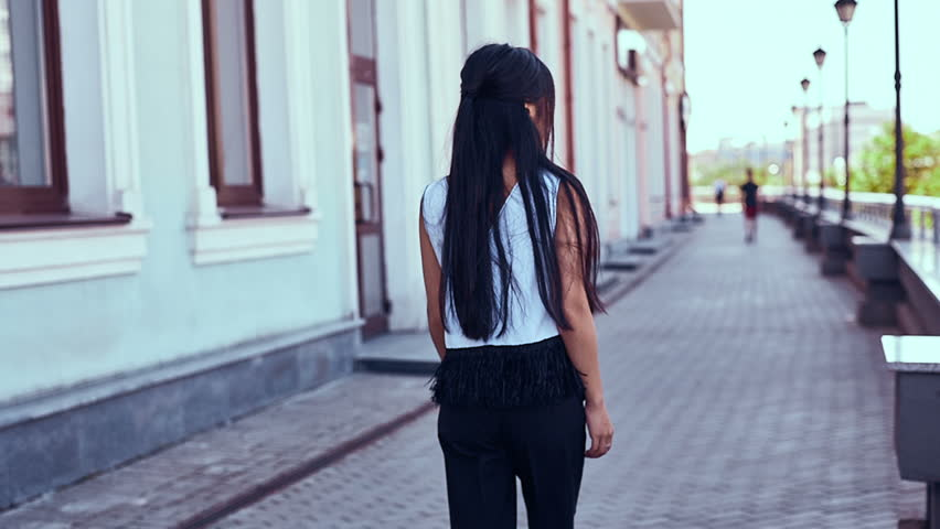 Portrait of a cute and gorgeous asian woman in fashion dress walking along bright european street | Shutterstock HD Video #31730053