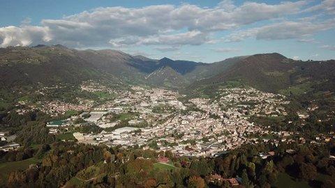 4K Drone aerial view to the villages of Leffe, Gandino, Peia and Cazzano Sant Andrea, located at Gandino Valley, Bergamo, Italy during autumn season