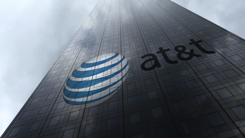 American Telephone and Telegraph Company AT T logo on a skyscraper facade reflecting clouds, time lapse. Editorial 3D rendering