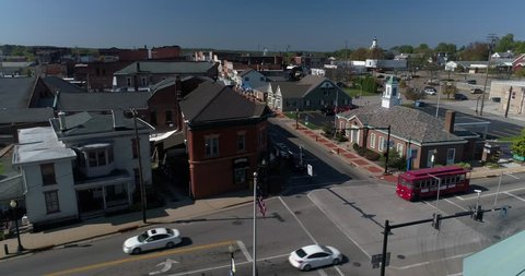 A slow forward dolly aerial establishing shot of the small town of Salem, Ohio's business district.