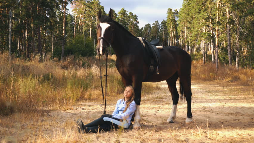 Beautiful Girl Is Sitting On Horse Back,Horse Is Grazing -3556