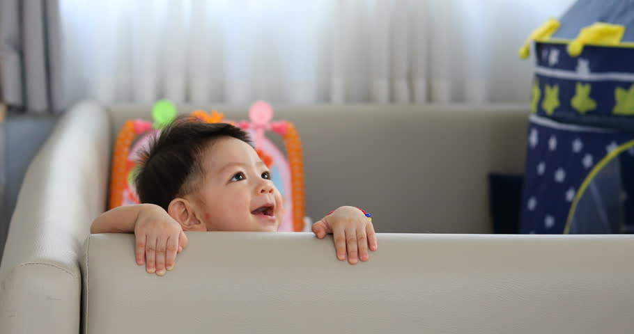 Cute baby boy happy in living room with soft pad mattress partition limit area self protection in family home | Shutterstock HD Video #31803952