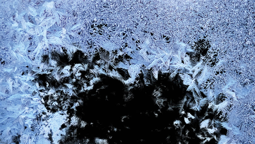 Beautiful window freezing animation from borders to center, timelapse frost forming transition, natural crystal icing, isolated on black background with black and white luminance matte, alpha channel.
