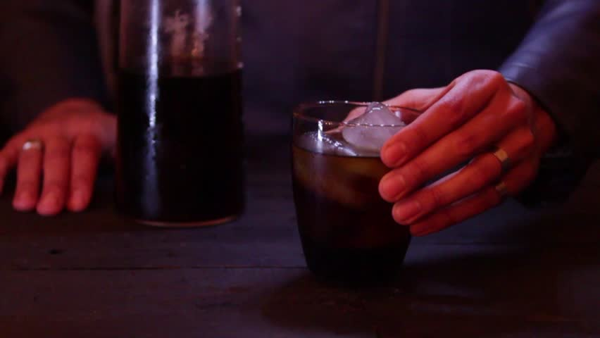 Bartender giving a cold drink to a client, first person | Shutterstock HD Video #31815556