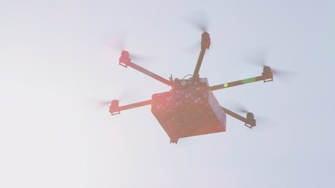 CLOSEUP LENS FLARE UAV Drone Delivering Goods Last Minute Gift Delivery By Cargo Multicopter