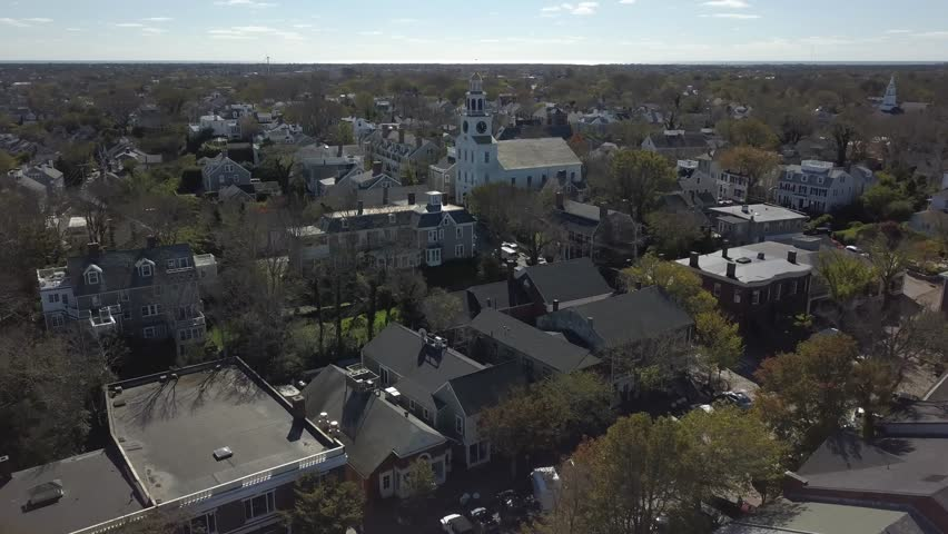 Nantucket Quaint Village close AERIAL. Nantucket, a tiny, isolated island off Cape Cod, Massachusetts, is a summer destination with beaches. It's marked by unpainted cedar-shingled buildings