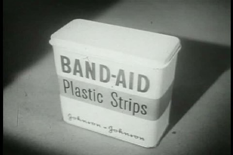 CIRCA 1950s - Various brands of adhesive strips are compared to Band-Aid Plastic Strips, in a television commercial, in the 1950s.