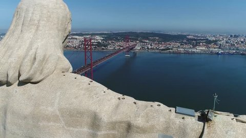 Aerial bird view flyby past Sanctuary of Christ the King Portuguese Santuario de Cristo Rei is Catholic monument and shrine dedicated to Sacred Heart of Jesus Christ overlooking city of Lisbon Almada