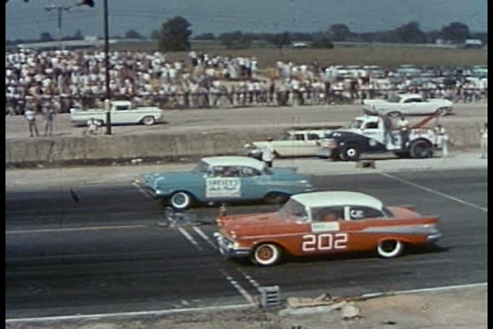 CIRCA 1950s - Various hot rods are driven, including a modified roadster, a Thunderbird, a Corvette and a Chevrolet, in the 5th Annual National Championship Drag Races, in Detroit, Michigan, in 1958.