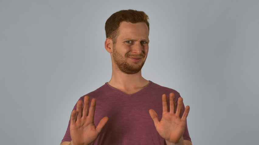 serious caucasian guy with red hair showing emotion disgusting. handsome redheaded men wearing in casual t-shirt. Portrait ginger young caucasian man on grey background