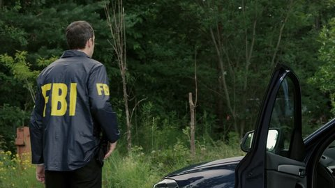 A Special Force Soldier talks to a FBI Agent.