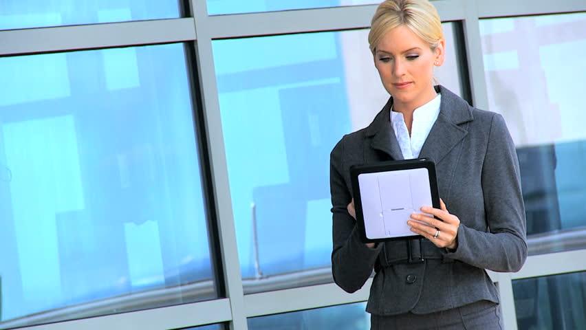 Two city businesswomen meeting up & using a wireless tablet outside modern office workplace   Shutterstock HD Video #3206752