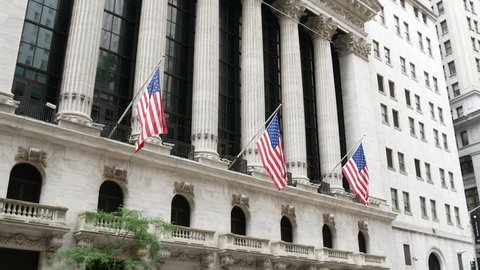 Facade of the Stock Exchange building on Wall Street in the financial district of New York City
