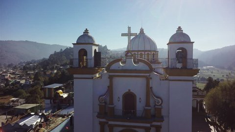 Aerial view of de las Casa San Cristobal in Mexico, flying above church tower bell