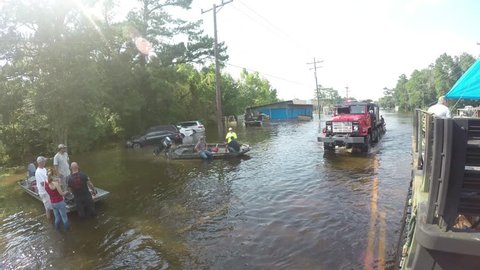 Houston, Texas - United States - August 27, 2017: Heavy equipment passing on flooded road in Houston, Texas