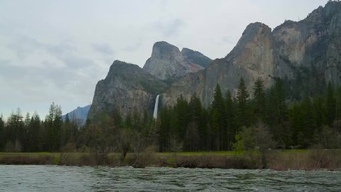 Yosemite national park. Spring flow on the top leap of yosemite falls in yosemite national park. View fwaterfalls and merced river in yosemite national park. Merced River In National Park.