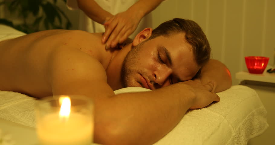 Attractive Young Man Relaxing At Beauty Spa Male Receiving Back Body Massage