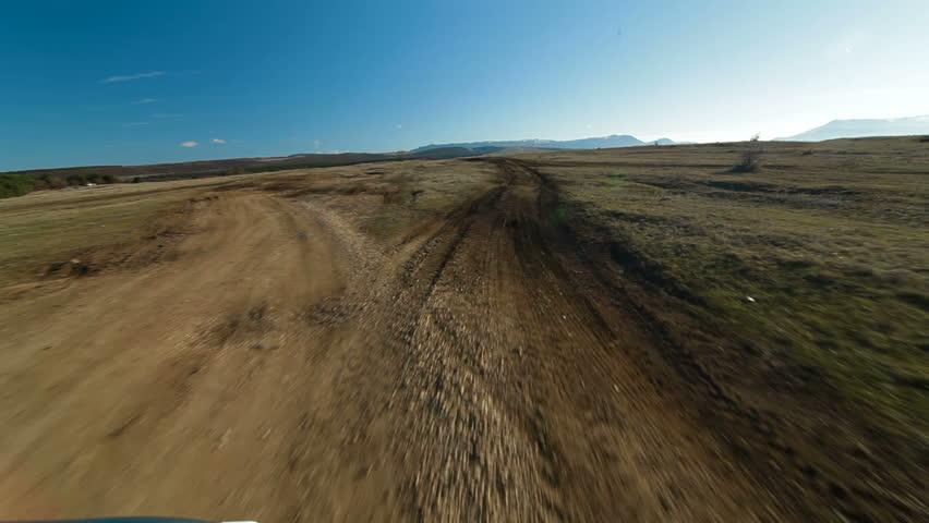 Off-road driving through a Crimean mountain plateau
