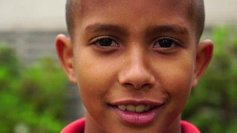 Portrait of Little Boy Looking the Camera