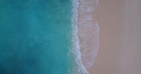 v10169 waves water texture breaking and crashing with drone aerial flying view of aqua blue and green clear sea ocean