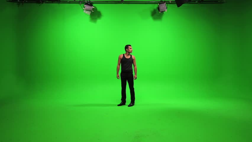 man standing in room and looking around. isolated against green screen background. male person people