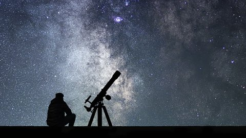 Man with astronomy telescope looking at the stars. Man telescope and starry sky. Night sky. Milky way galaxy Time Lapse.