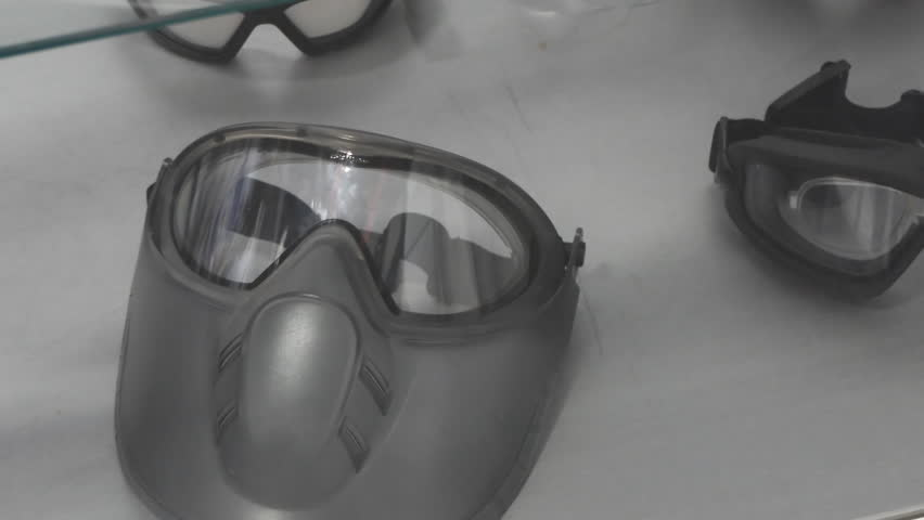 Health and safety. Protective face masks and glasses for various industries on display | Shutterstock HD Video #32167942